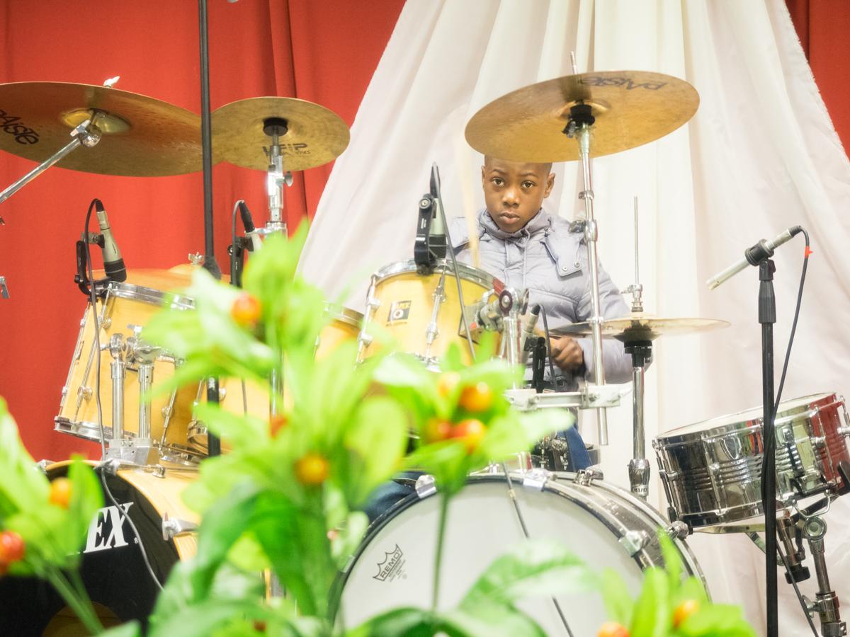 Gabriel Opoku play the drum