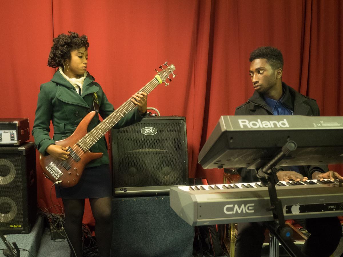 Nina Nkansah (on the bass guitar) and Justice Nkansah (on the keyboard)