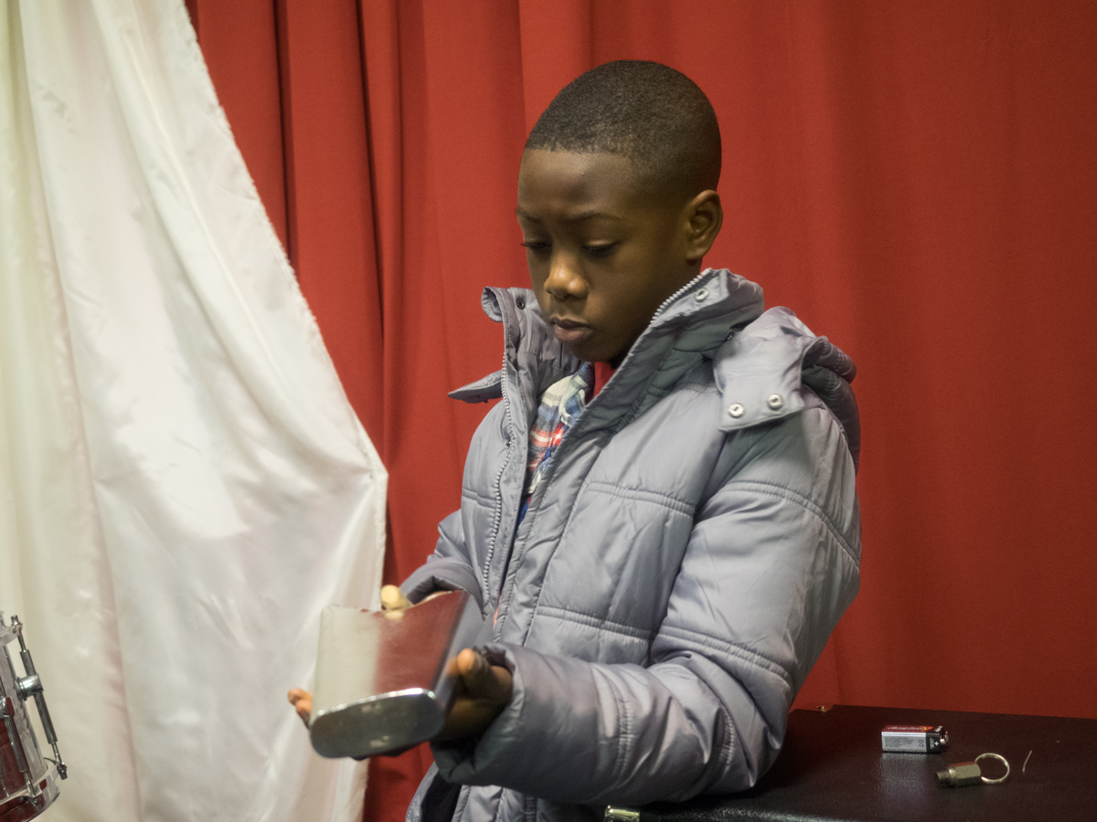 Gabriel Opoku play the percussion